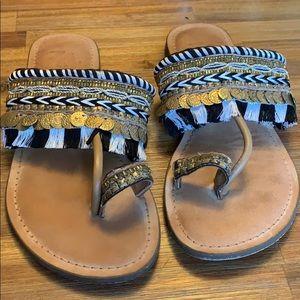 Gold embellishes summer sandals.